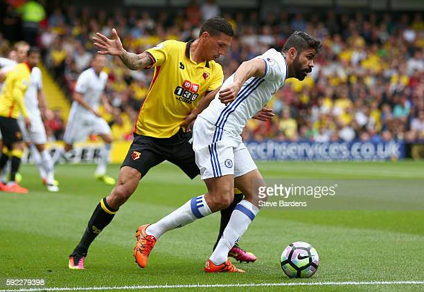 Craig Cathcart of Watford and Diego Costa of Chelsea battle for possession during the Premier League match between Watford and Chelsea at Vicarage...