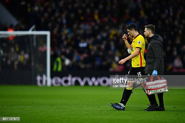 Craig Cathcart of Watford walks off the pitch as he picks up injury during The Emirates FA Cup Third Round match between Watford and Burton Albion at...