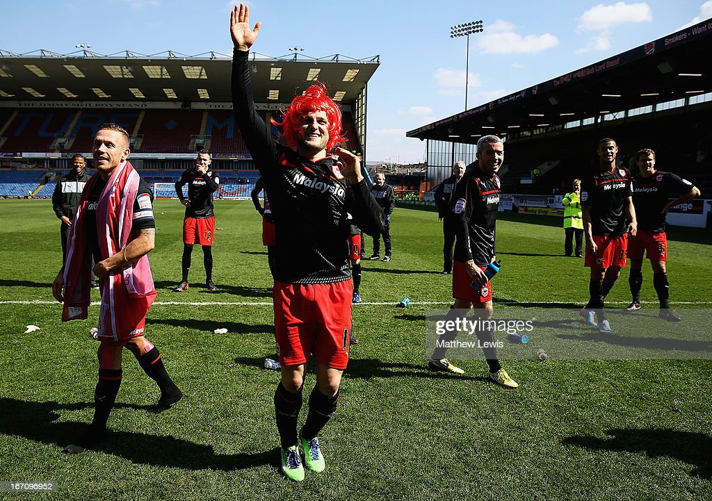 Craig Conway of Cardiff City celebrates his team going up to the Premiership after the npower Championship match between Burnley and Cardiff City at Turf Moor on April 20, 2013 in Burnley, England.