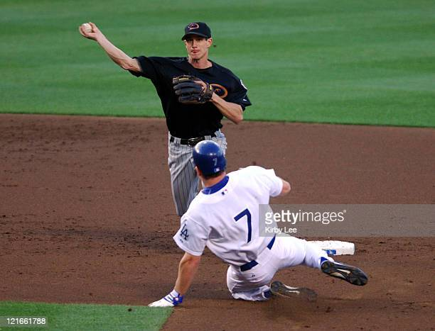 Craig Counsell of the Arizona Diamondbacks throws over JD Drew of the Los Angeles Dodgers to complete a double play during 103 victory at Dodger...