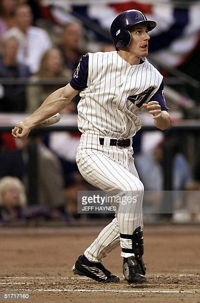 Craig Counsell of the Arizona Diamondbacks watches his first inning solo home run in game one of the 2001 World Series against the New York Yankees...