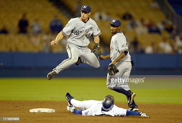 Craig Counsell of the Brewers turns a double play in the 8th inning during a game against the Los Angeles Dodgers at Dodger Stadium June 1 2004