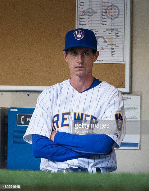 Craig Counsell of the Milwaukee Brewers in the dugout before the start of the game against the Chicago Cubs at Miller Park on July 31 2015 in...