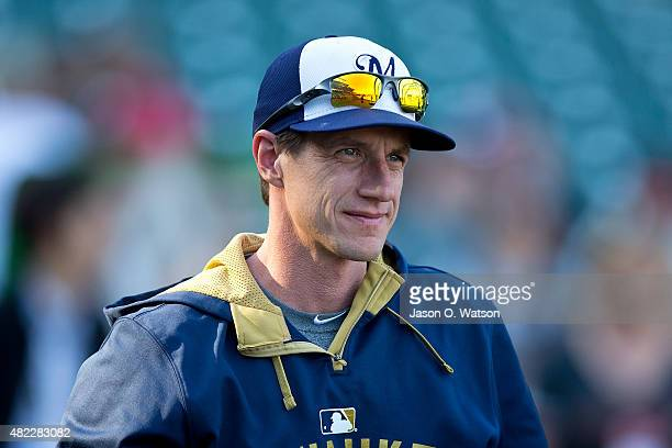Craig Counsell of the Milwaukee Brewers watches his team during batting practice before the game against the San Francisco Giants at ATT Park on July...
