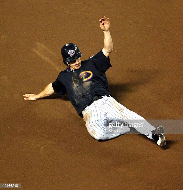 Craig Counsell slides into third base in the fourth inning of 103 victory over the Los Angeles Dodgers at Dodger Stadium in Los Angeles Calif on...