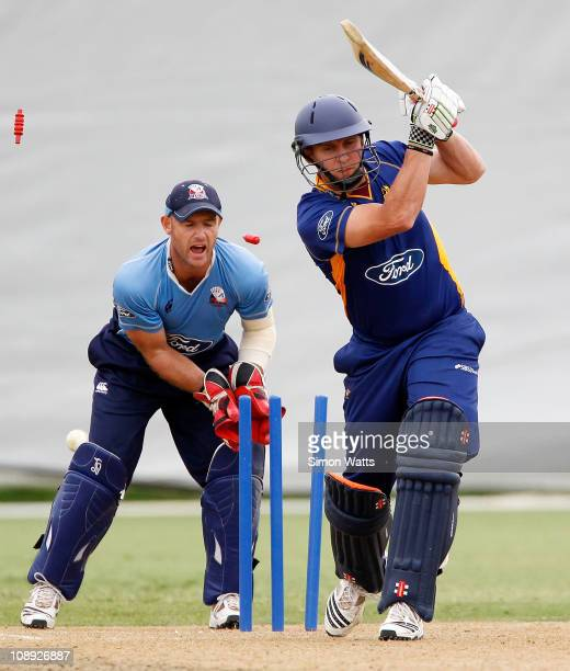 Craig Cumming of the Volts is bowled by Colin de Grandhomme as the Aces keeper Gareth Hopkins watches during the one day semi final match between...