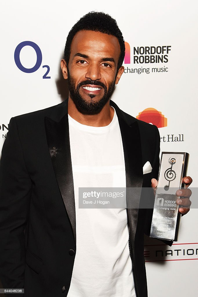 <a gi-track='captionPersonalityLinkClicked' href=/galleries/search?phrase=Craig+David&family=editorial&specificpeople=210646 ng-click='$event.stopPropagation()'>Craig David</a> poses with the American Express Innovation Award during the Nordoff Robbins O2 Silver Clef Awards on July 1, 2016 in London, United Kingdom.