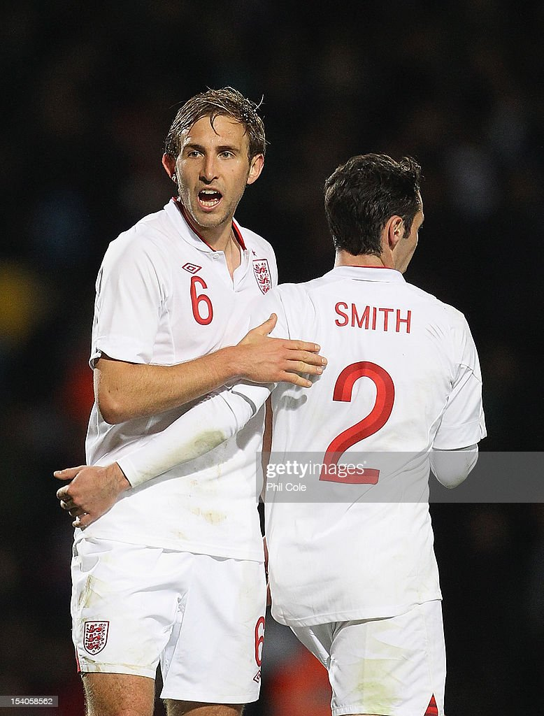 Craig Dawson of England with Adam Smith after the final whistle in the Under 21 European Championship Play Off between England U21 and Serbia U21 at Carrow Road on October 12, 2012 in Norwich, England.
