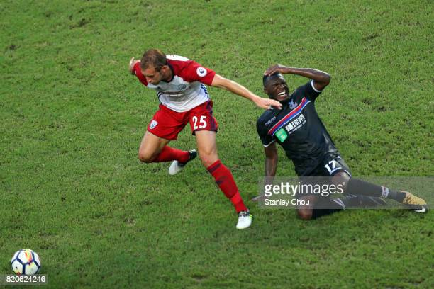 Craig Dawson of West Brombich Albion shakes off Christian Benteke of Crystal Palace during the Premier League Asia Trophy match between West Brom and...