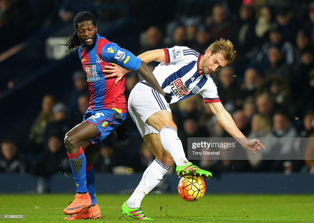 Craig Dawson of West Bromwich Albion and Emmanuel Adebayor of Crystal Palace compete for the ball during the Barclays Premier League match between West Bromwich Albion and Crystal Palace at The Hawthorns on February 27, 2016 in West Bromwich, England.