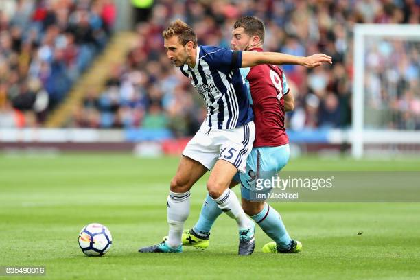 Craig Dawson of West Bromwich Albion and Sam Vokes of Burnley battle for possession during the Premier League match between Burnley and West Bromwich...