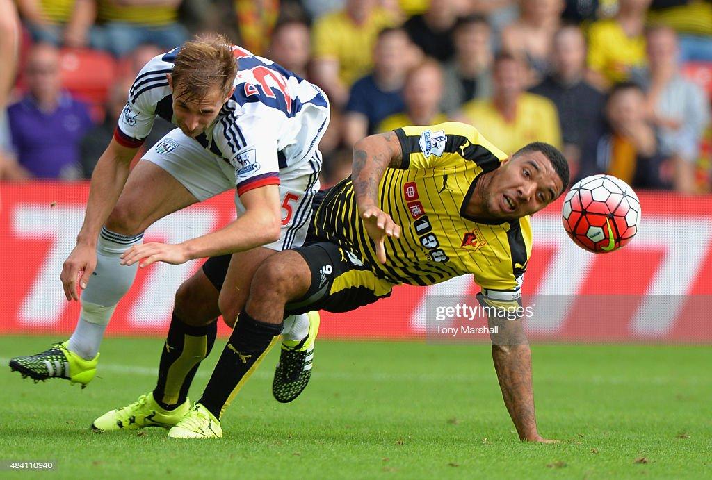 Craig Dawson of West Bromwich Albion and Troy Deeney of Watford compete for the ball during the Barclays Premier League match between Watford and West Bromwich Albion at Vicarage Road on August 15, 2015 in Watford, United Kingdom.