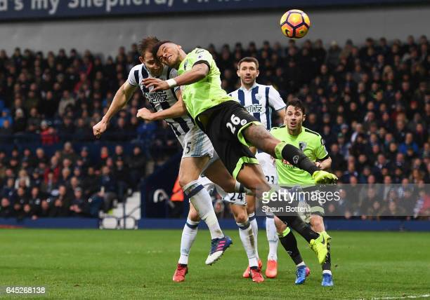 Craig Dawson of West Bromwich Albion and Tyrone Mings of AFC Bournemouth battle to win a header during the Premier League match between West Bromwich...