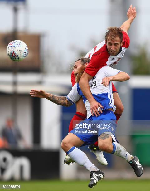 Craig Dawson of West Bromwich Albion challenges Stuart Sinclair of Bristol Rovers during the pre season match between Bristol Rovers and West...
