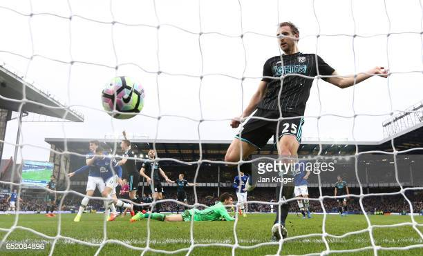 Craig Dawson of West Bromwich Albion fails to stop Kevin Mirallas of Everton from scoring their first goal during the Premier League match between...