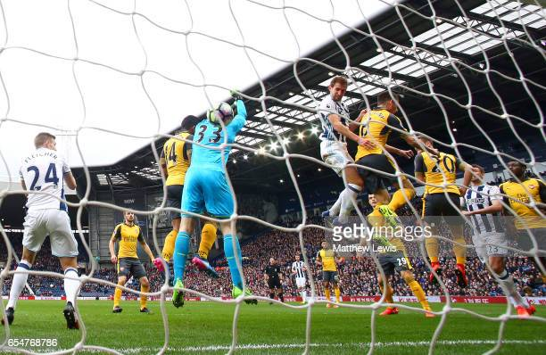 Craig Dawson of West Bromwich Albion scores his sides first goal past Petr Cech of Arsenal during the Premier League match between West Bromwich...