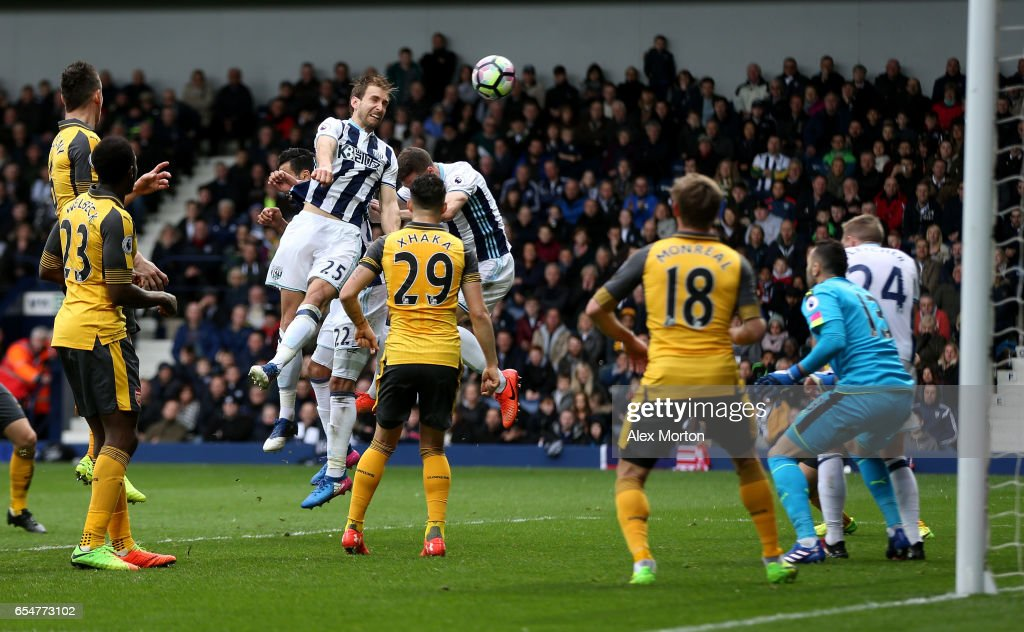 Craig Dawson of West Bromwich Albion (L) scores his sides third goal during the Premier League match between West Bromwich Albion and Arsenal at The Hawthorns on March 18, 2017 in West Bromwich, England.