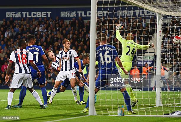 Craig Dawson of West Bromwich Albion scores their second goal past goalkeeper Tim Howard of Everton during the Barclays Premier League match between...