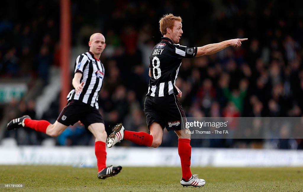 Craig Disley (R) of Grimsby celebrates after scoring the opening goal during the FA Trophy semi final match between Grimsby Town and Dartford at Blundell Park on February 16, 2013 in Grimsby, England.
