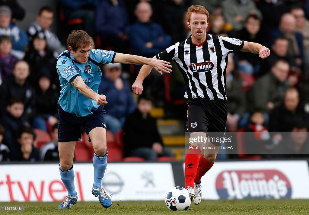 Craig Disley (R) of Grimsby in action with Richard Rose of Dartford during the FA Trophy semi final match between Grimsby Town v Dartford at Blundell Park on February 16, 2013 in Grimsby, England.