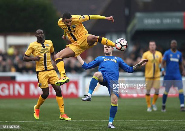 Craig Eastmond of Sutton United acrobatically kicks the ball during The Emirates FA Cup Third Round match between Sutton United and AFC Wimbledon at...