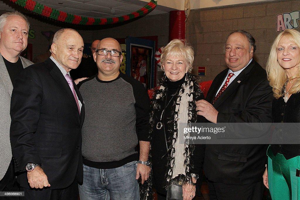 Craig Eaton, Raymond Kelly, Joe Rao, Veronica Kelly, John Catsimatidis and Margo Catsimatidis attend CitySightseeing New York 2013 holiday toy drive at PAL's Harlem Center on December 14, 2013 in New York City.
