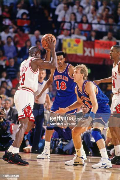Craig Ehlo of the Cleveland Cavaliers defends Michael Jordan of the Chicago Bulls at the Chicago Stadium in Chicago Illinois circa 1991 NOTE TO USER...