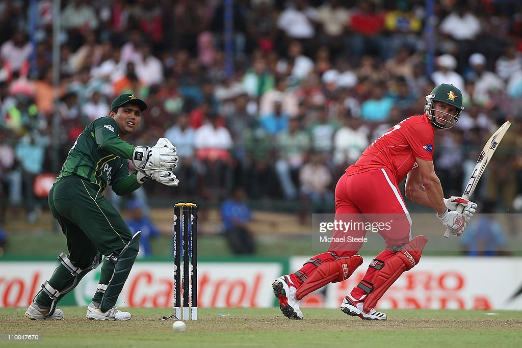 Craig Ervine (R) of Zimbabwe plays fine to the legside as wicketkeeper <a gi-track='captionPersonalityLinkClicked' href=/galleries/search?phrase=Kamran+Akmal&family=editorial&specificpeople=221679 ng-click='$event.stopPropagation()'>Kamran Akmal</a> (L) looks on during the Pakistan v Zimbabwe 2011 ICC World Cup Group A match at the Pallekele Cricket Stadium on March 14, 2011 in Kandy, Sri Lanka.