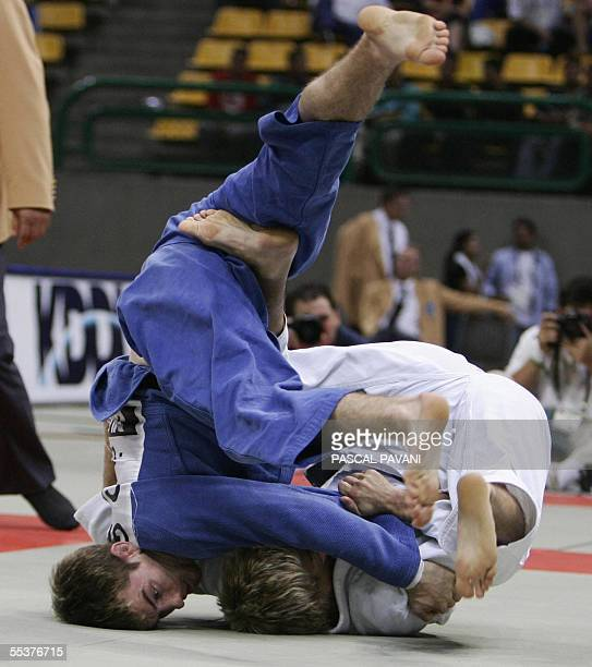 Craig Fallon of Great Britain competes against Ludwi Paischer of Austria for the 60 men class match at the World Judo Championships in Cairo 11...