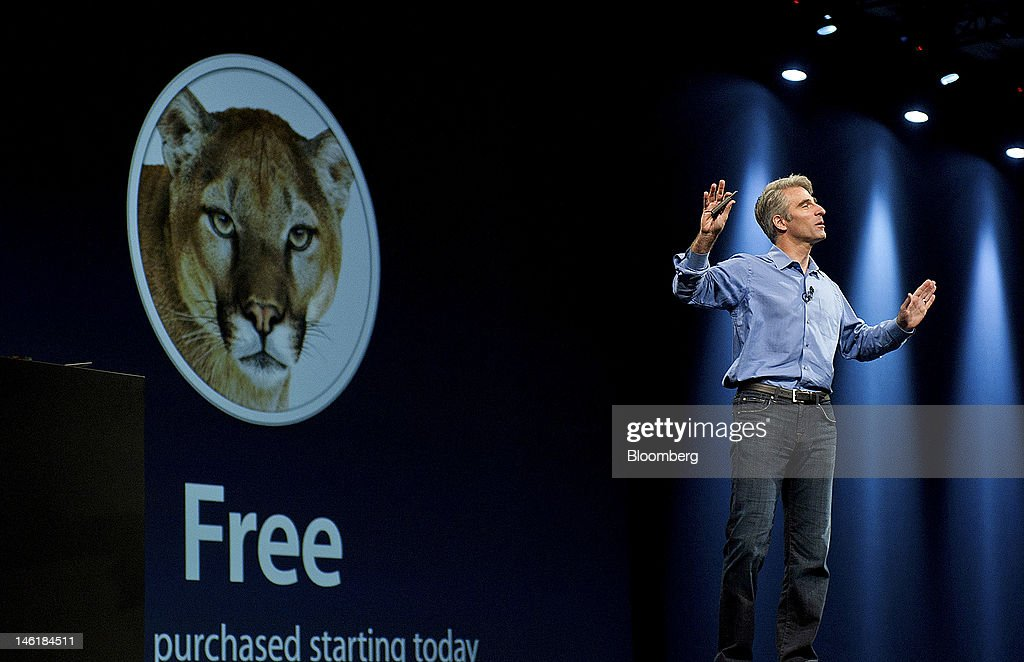 Craig Federighi, senior vice president of Software Engineering for Apple Inc., announces the new Mountain Lion operating system during the Apple Worldwide Developers Conference in San Francisco, California, U.S., on Monday, June 11, 2012. Apple Inc. is releasing a fresh lineup of computers and software tools to woo consumers and keep developers making applications amid accelerating rivalry from Google Inc., Microsoft Corp. and, now, Facebook Inc. Photographer: David Paul Morris/Bloomberg via Getty Images