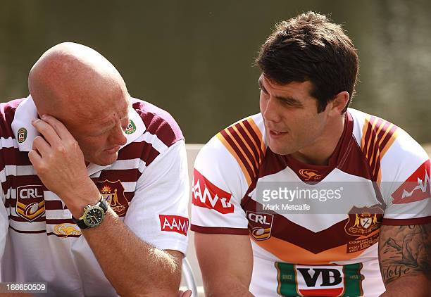 Craig Fitzgibbon and Michael Ennis talk during a Country origin team photo at Allianz Stadium on April 15 2013 in Sydney Australia