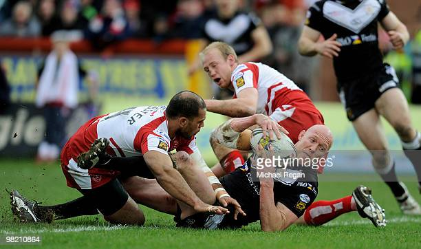 Craig Fitzgibbon of Hull FC rolls over to score his teams 2nd try during the engage Super League match between Hull Kingston Rovers and Hull FC at...