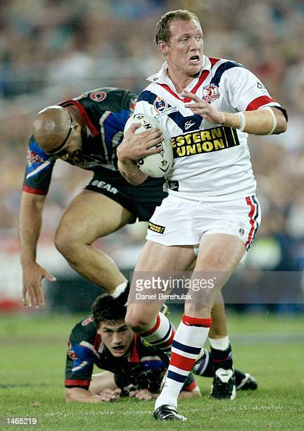 Craig Fitzgibbon of the Roosters in action during the 2002 NRL Grand Final played between the Sydney Roosters and the New Zealand Warriors held at...