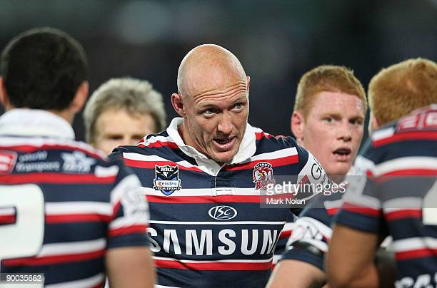 Craig Fitzgibbon of the Roosters talks to his team mates after a Bulldogs try during the round 24 NRL match between the Bulldogs and the Sydney...