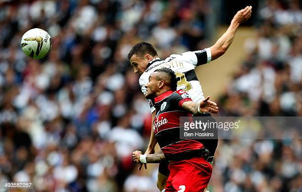 Craig Forsyth of Derby battles with Danny Simpson of QPR during the Sky Bet Championship Playoff Final match between Derby County and Queens Park...