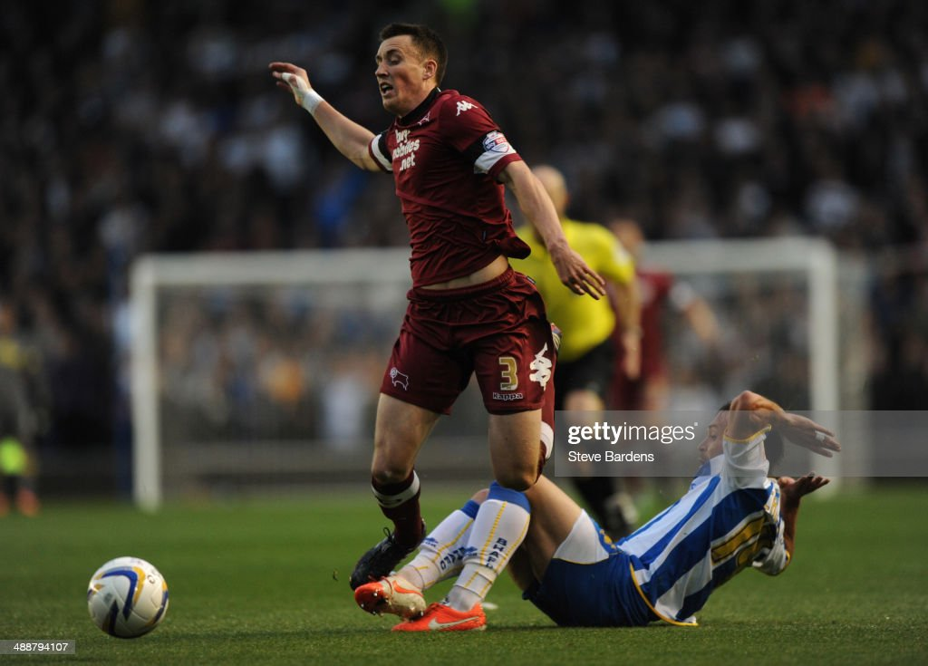 Craig Forsyth of Derby County is tackled by Inigo Calderon of Brighton & Hove Albion during the Sky Bet Championship Play Off semi final first leg match between Brighton & Hove Albion and Derby County at Amex Stadium on May 8, 2014 in Brighton, England.