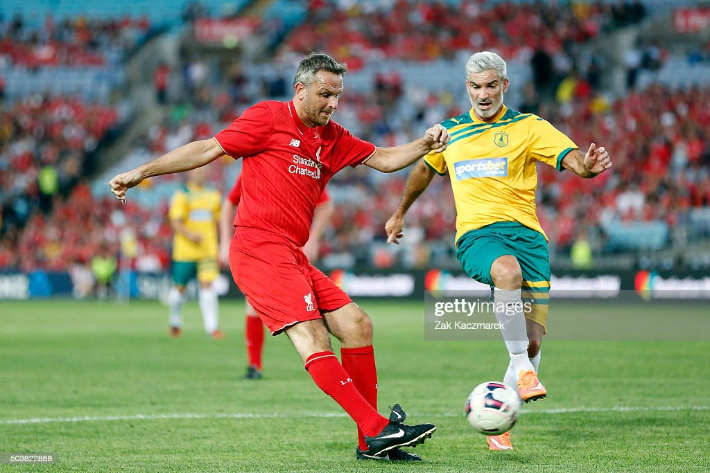 Craig Foster of the Australian Legends is challenged by <a gi-track='captionPersonalityLinkClicked' href=/galleries/search?phrase=Dietmar+Hamann&family=editorial&specificpeople=204639 ng-click='$event.stopPropagation()'>Dietmar Hamann</a> of Liverpool FC Legends during the match between Liverpool FC Legends and the Australian Legends at ANZ Stadium on January 7, 2016 in Sydney, Australia.