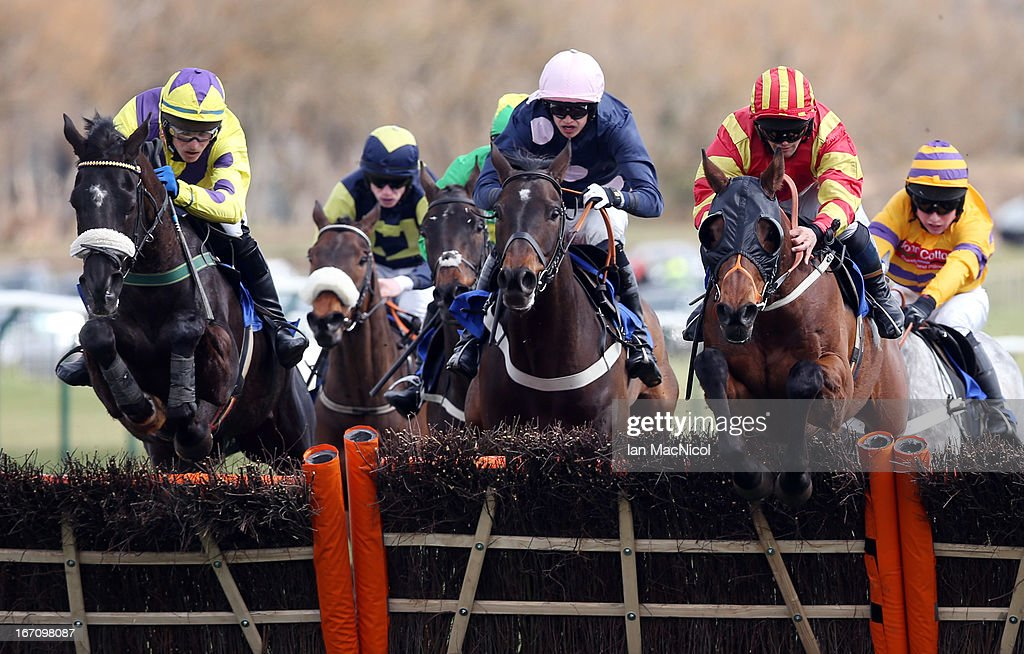 Craig Gallagher (Yellow and Red) on his way to winning the Yesss Electrical Racing Excellence 'Hands and Heels' Finale Handicap Hurdle Race (1.30) on his mount Mubrook, at Ayr racecourse on April 20, 2013 in Ayr, Scotland.
