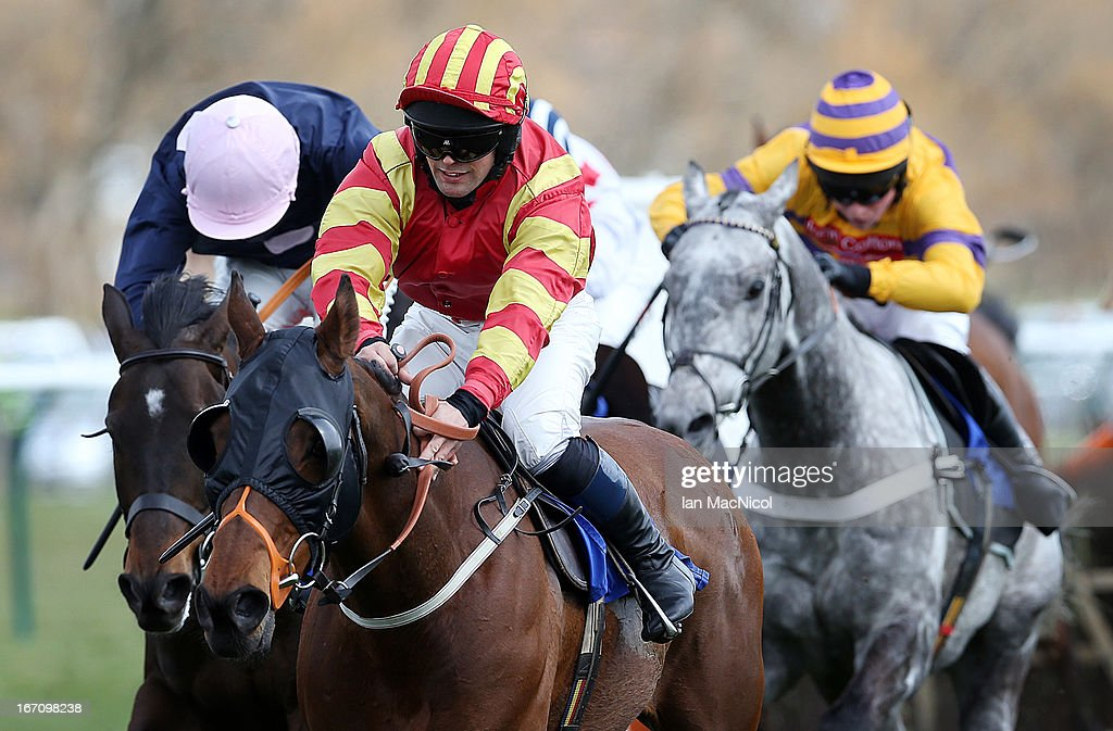 Craig Gallagher (Yellow and Red) rides Mubrook on his way to winning the Yesss Electrical Racing Excellence 'Hands and Heels' Finale Handicap Hurdle Race (1.30) at Ayr Racecourse on April 20, 2013 in Ayr, Scotland.