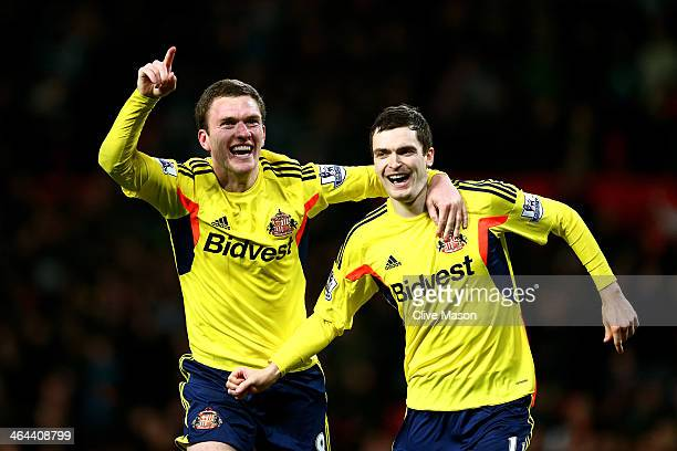 Craig Gardner and Adam Johnson of Sunderland celebrate following their team's victory in the penalty shootout during the Capital One Cup semi final...