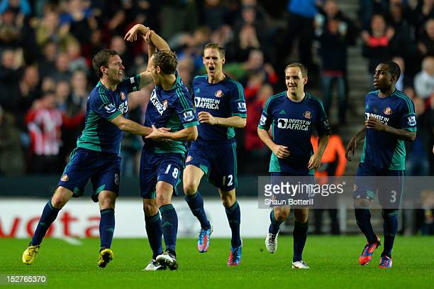Craig Gardner of Sunderland celebrates scoring the first goal with David Meyler of Sunderland during the Captial One Cup third round match between MK...