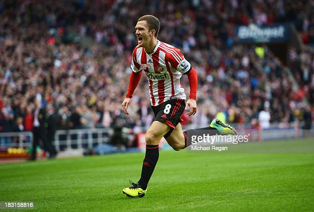 Craig Gardner of Sunderland celebrates scoring the opening goal during the Barclays Premier League match between Sunderland and Manchester United at...