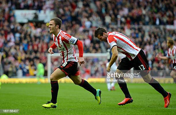 Craig Gardner of Sunderland celebrates scoring the opening goal with Ondrej Celustka during the Barclays Premier League match between Sunderland and...