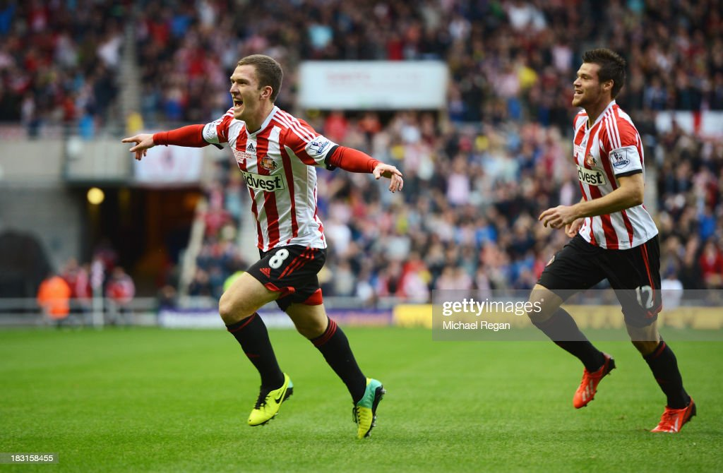 <a gi-track='captionPersonalityLinkClicked' href=/galleries/search?phrase=Craig+Gardner&family=editorial&specificpeople=685283 ng-click='$event.stopPropagation()'>Craig Gardner</a> (L) of Sunderland celebrates scoring the opening goal with Ondrej Celustka during the Barclays Premier League match between Sunderland and Manchester United at the Stadium of Light on October 5, 2013 in Sunderland, England.