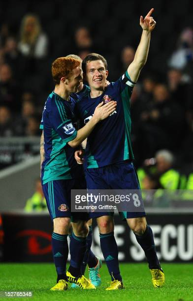 Craig Gardner of Sunderland celebrates scoring their first goal with Jack Colback of Sunderland during the Captial One Cup third round match between...