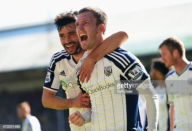 Craig Gardner of West Brom celebrates scoring their second goal with Claudio Yacob of West Brom during the Barclays Premier League match between...