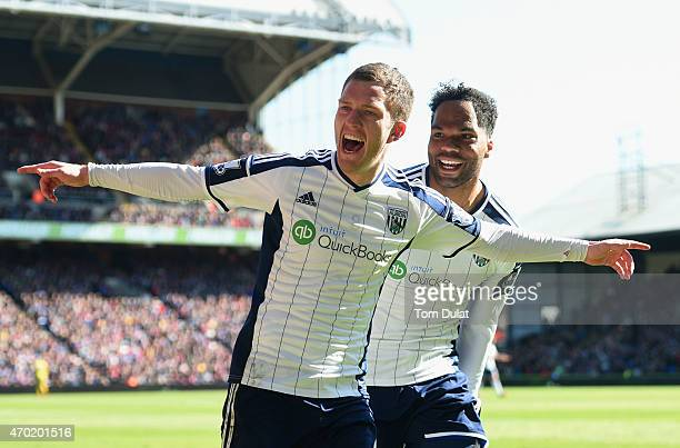 Craig Gardner of West Brom celebrates scoring their second goal with Joleon Lescott of West Brom during the Barclays Premier League match between...