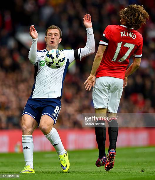 Craig Gardner of West Brom is closed down by Daley Blind of Manchester United during the Barclays Premier League match between Manchester United and...