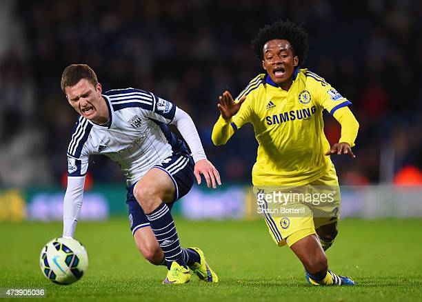 Craig Gardner of West Bromwich Albion and Juan Cuadrado of Chelsea stumble as they battle for the ball during the Barclays Premier League match...