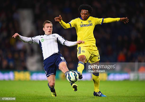 Craig Gardner of West Bromwich Albion and Juan Cuadrado of Chelsea battle for the ball during the Barclays Premier League match between West Bromwich...